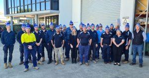 Siganto Staff group photo wearing MND beanies